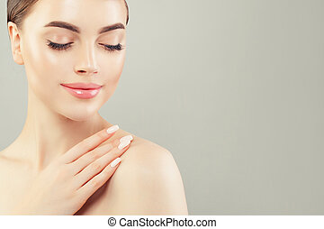 Relaxing woman with clear healthy skin on white background