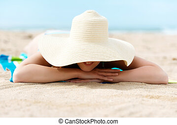 Relaxing Woman With Sunhat At Beach