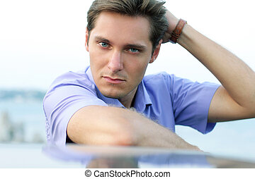 Relaxing young handsome man, outdoor portrait