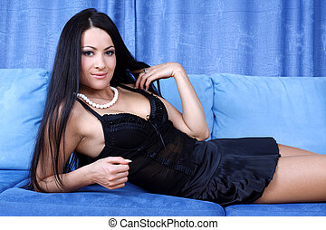 relaxing young woman in sofa at home