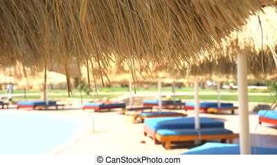 Relaxing zone near swimming pool - Relaxing zone with sofa...