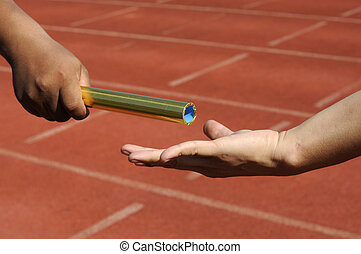 Relay-athletes hands sending action. - Relay-athletes hands...