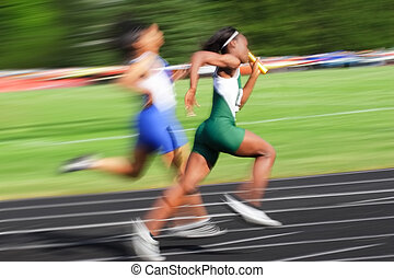 Relay race (motion blur) - Two runners race to the finish ...