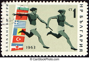 Relay race on post stamp - BULGARIA - CIRCA 1963: A post...
