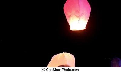 Releasing sky lanterns - Releasing lanterns to the sky at...