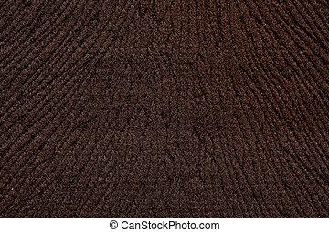 Relief tissue background in dark brown tone.