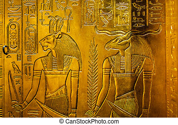Relief in gold with the egypt gods Sekhmet and Chnum
