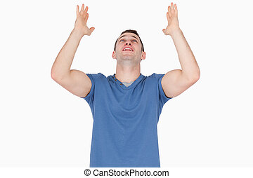 Relieved young man against a white background