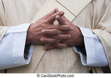 Religion - A close up of a pastor praying