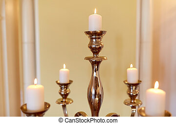 candles burning in church or palace - religion and...