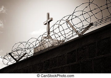 Religion and war - cross behind barbed wire - Religion and...