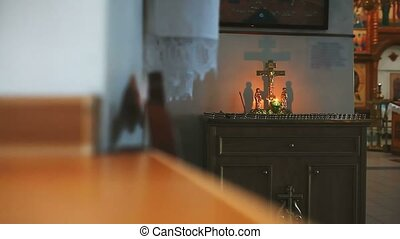 religion church burning candle on background of the cross with Jesus