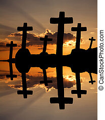 religion - cross at the sunset and the orange clouds