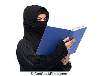 muslim woman in hijab reading book over white - religion,...