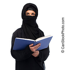muslim woman in hijab reading book over white