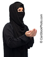 praying muslim woman in hijab over white