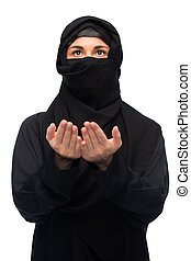 praying muslim woman in hijab over white - religion, faith,...