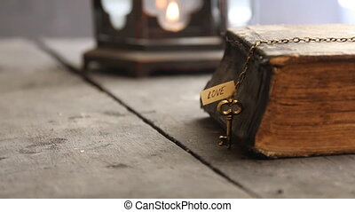 religion idea, old Bible and golden key with word love