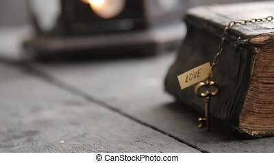 religion idea, old Bible and key with inscription love