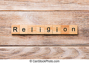 Religion word written on wood block. Religion text on wooden table for your desing, concept
