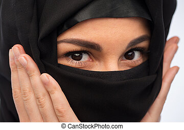 close up of muslim woman in hijab - religious and people...