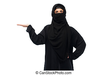 muslim woman in hijab holding empty hand