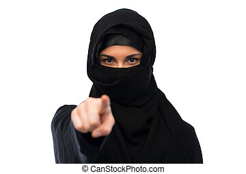 muslim woman in hijab pointing finger to you - religious and...