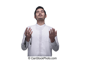 Religious asian muslim man praying with using tasbih