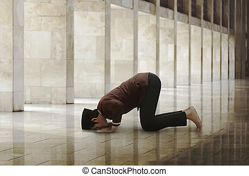 Religious asian muslim man worship to his god