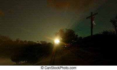 Religious believers praying at Jesus cross against beautiful sunset