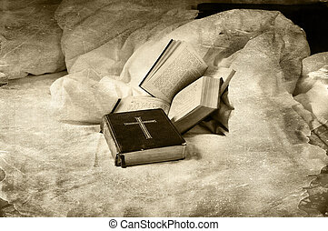 Religious books abandoned on a unmade bed grungy dark style.
