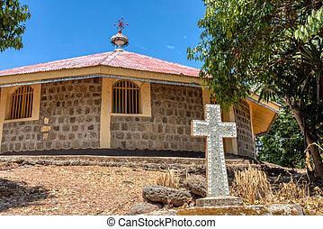 religious christian cross behind Entos Eyesu UNESCO Monastery situated on small island on lake Tana near Bahir Dar. Ethiopia Africa