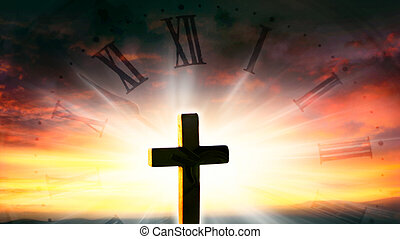 Religious christian cross with sunset sky .
