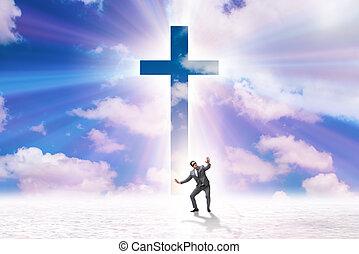 Religious concept with cross and lonely man