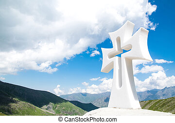 Religious cross in the mountains