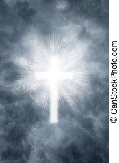 Religious cross shining through clouds - Heavenly rays...