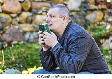 Religious man with Holy Bible