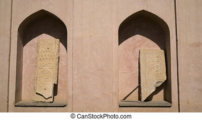 Religious monument detail with mihrab niche and damaged ...