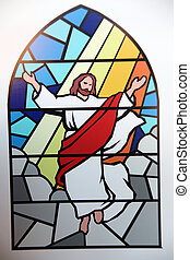 Religious stained glass window inside a place of worship.