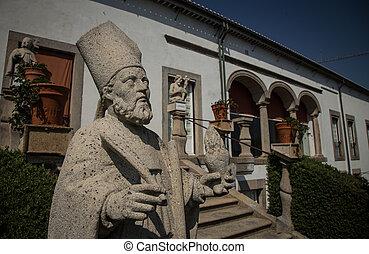 religious statue in a garden in portugal