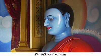 Religious Statue inside Buddhist Temple in Sri Lanka. 4k DCI footage