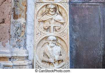 Religious stone carving on walls in Sicily, Italy