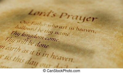 Scrolling religious text on an old paper background of the Lord's Prayer.