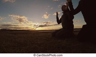 Religious two men muslim man praying nature sunset...