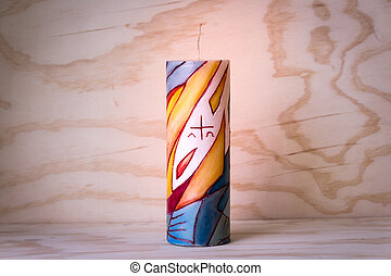 Religious wax candle with symbols