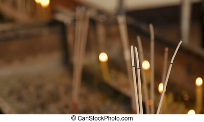 Religious yellow candles and aromasticks. Wat Saket,...