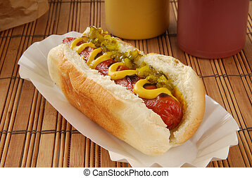 A hot dog with relish and mustard