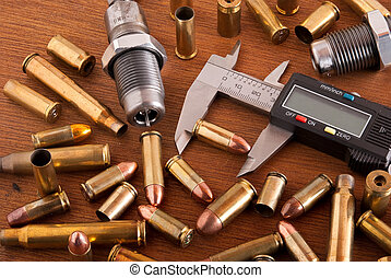 Reloading ammo - Realoding bench with cartridges and shell...