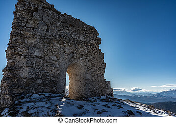 Remains of an ancient fortress on the snowy mountains