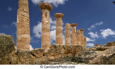 Remains of an ancient Greek temple of Heracles (V-VI century BC), Valley of the Temples, Agrigento, Sicily. The area was included in the UNESCO Heritage Site list in 1997